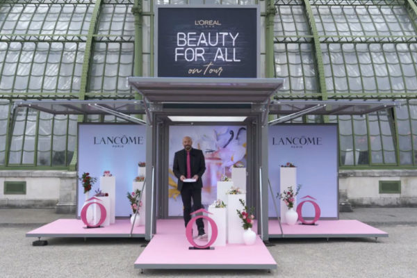 L'Oreal booth in front of glasshouse